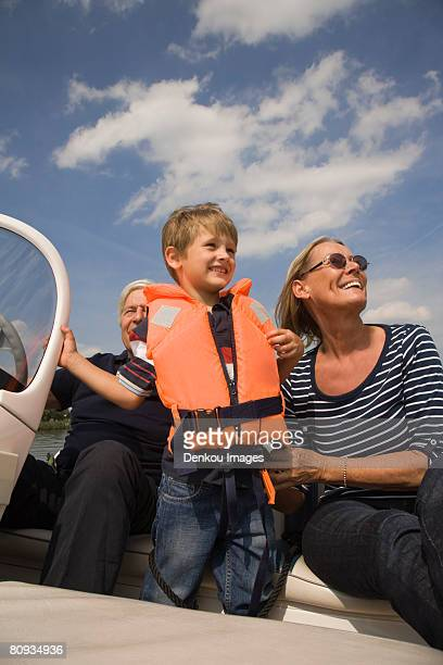 Grandparents and grandson on boat