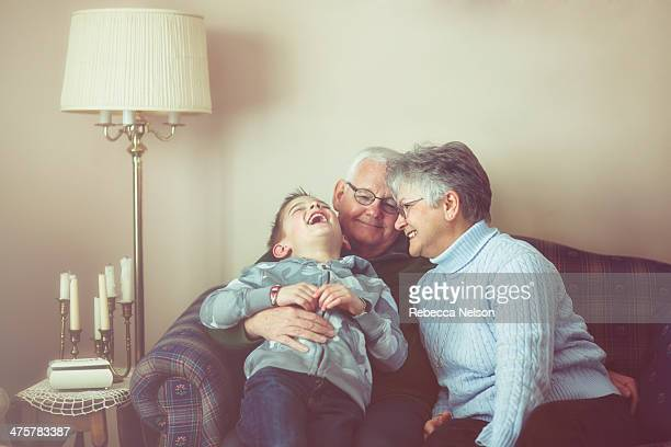 grandparents and grandson sharing a laugh