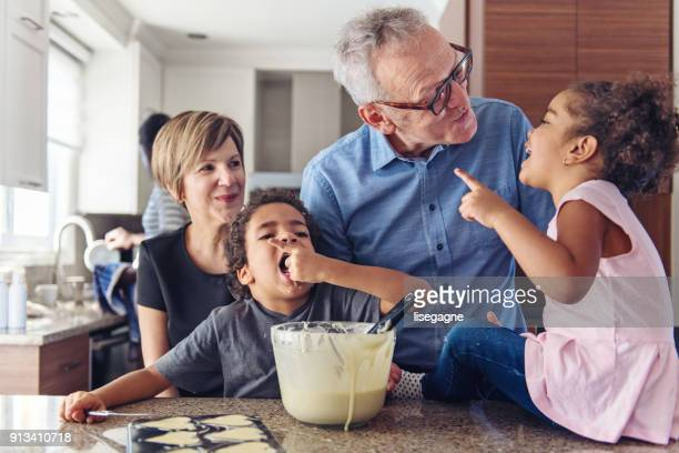 grandparents cooking with kids - multigenerational family stock photos and pictures