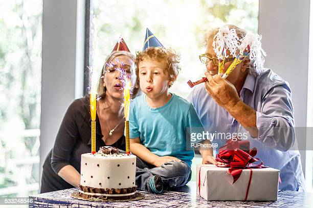 grandparents enjoys party with nephew - nephew stock pictures, royalty-free photos & images