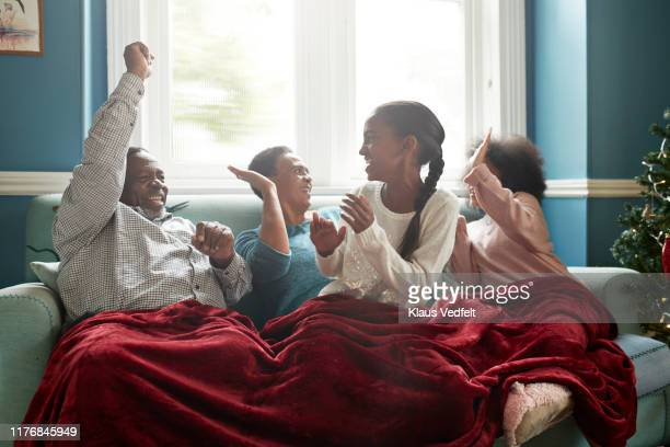 Grandparents giving high-five to granddaughters