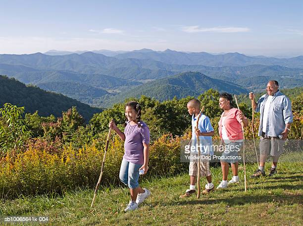 Grandparents hiking with grand children (10-13) Blue Ridge Mountains in background