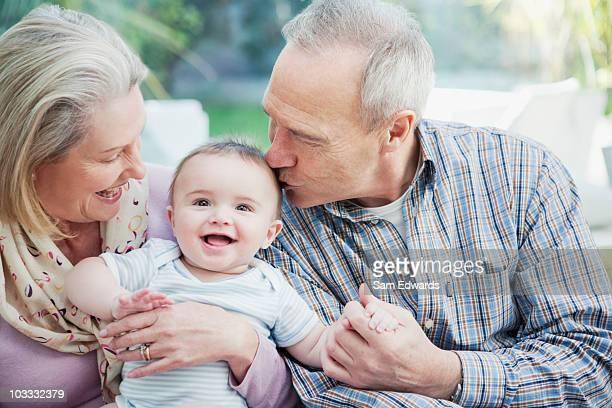 Grandparents holding baby grandson
