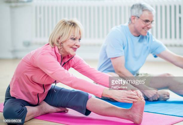 grandparents in exercise class - fat granny stock pictures, royalty-free photos & images