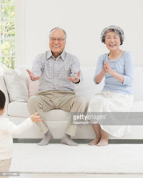 Grandparents Looking At Their Grandson