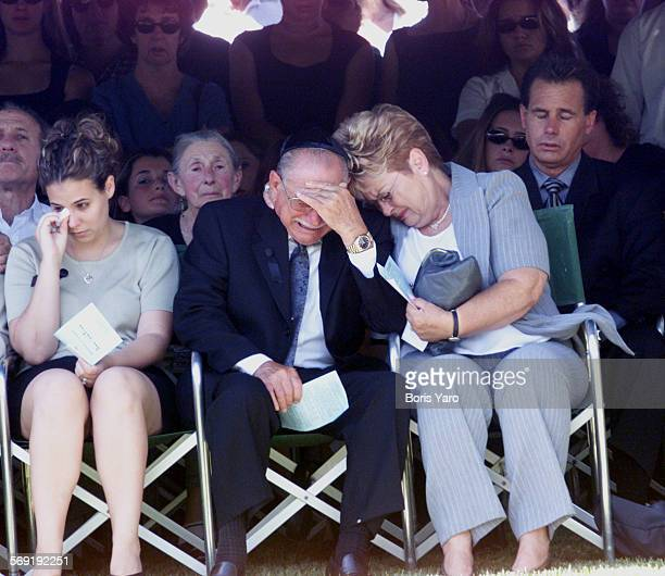 Grandparents of Nicholas Samuel Markowitz weep during funeral services for the murdered teenager