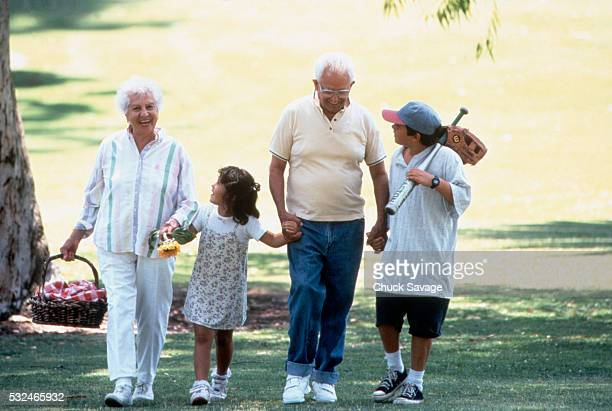 grandparents on an outing with their grandkids - mexican picnic stock pictures, royalty-free photos & images