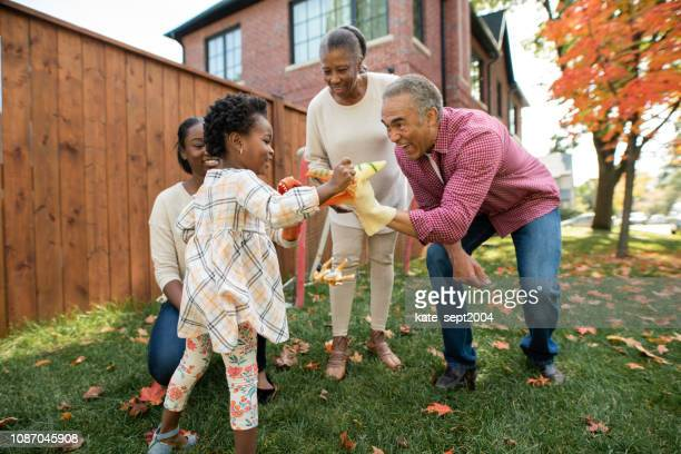 grandparents, parent and granddaughter together - interracial wife stock pictures, royalty-free photos & images