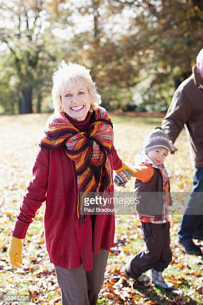 grandparents playing in park with grandson - british granny stock photos and pictures