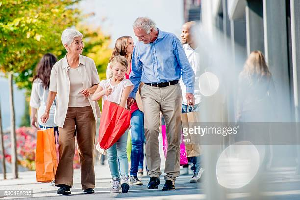 Grandparents Shopping with Their Granddaughter