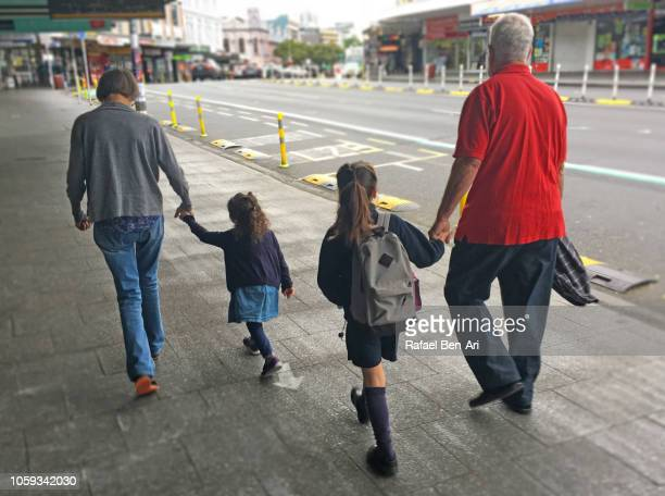 Grandparents Walking their Two Granddaughters ro School