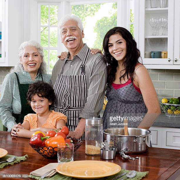 grandparents with daughter and granddaughter (6-7 years) in kitchen, portrait - 55 59 years stock pictures, royalty-free photos & images