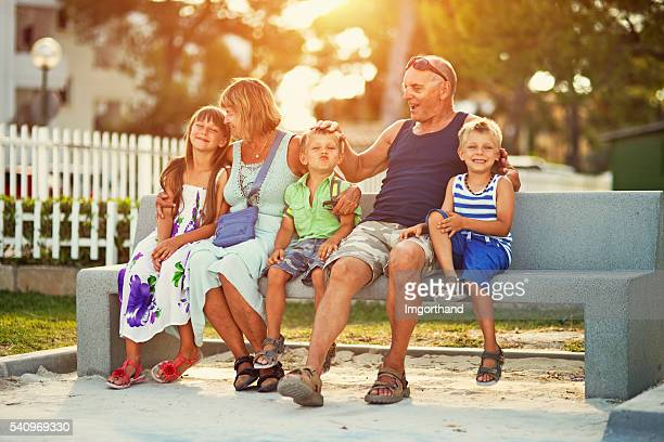 grandparents with grandchildren on vacations - imgorthand stock photos and pictures