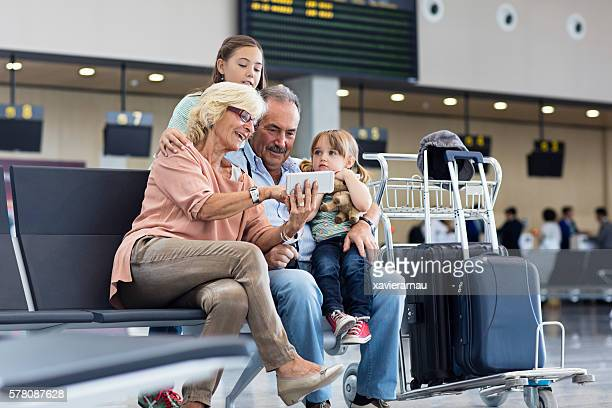 Grandparents with granddaughter travelling together on holidays