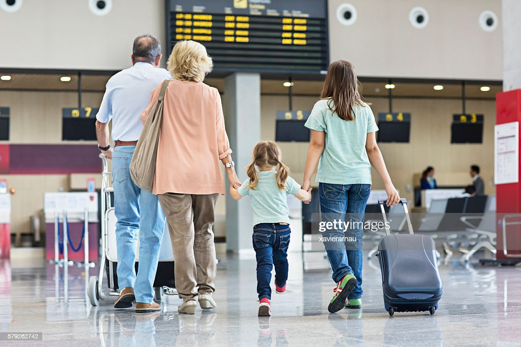 Grandparents with granddaughters travelling together on holidays : Stock Photo