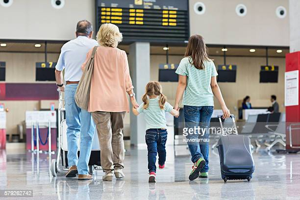 Grandparents with granddaughters travelling together on holidays