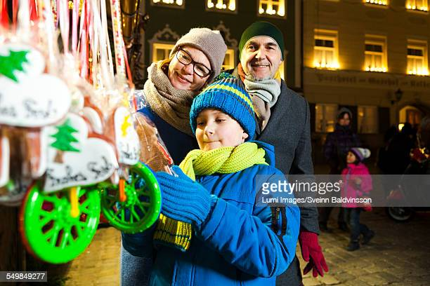 Grandparents with grandson at Christmas Market, Bad Toelz, Bavaria, Germany