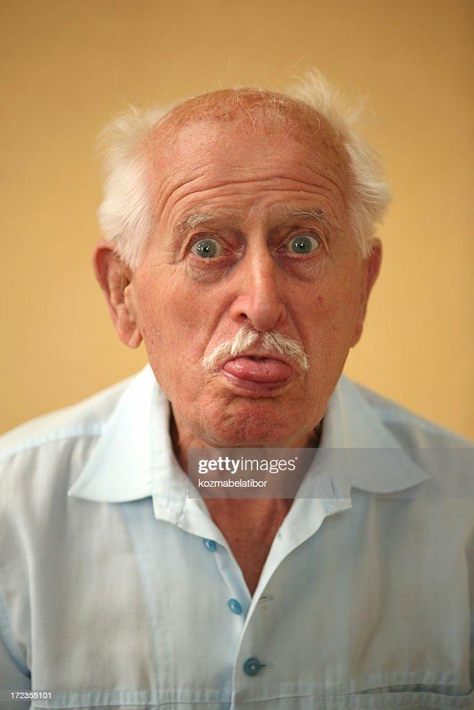 grandpa's tongue out : Stock Photo