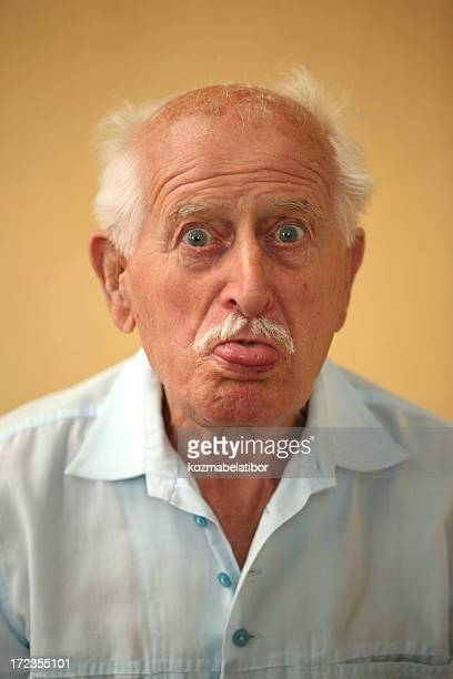 grandpa's tongue out - ugly bald man stock photos and pictures