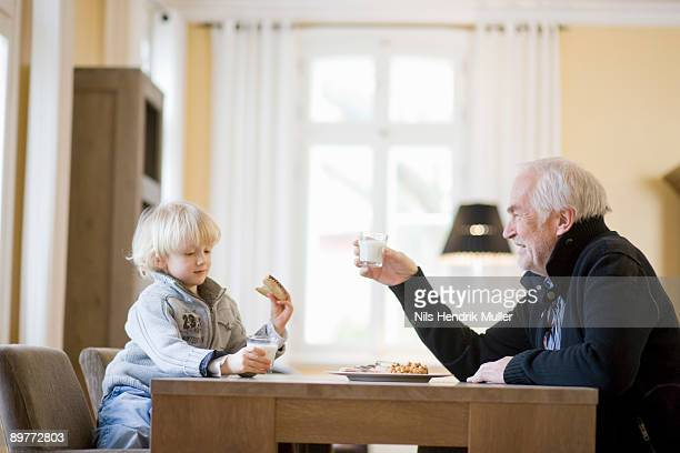 grandson and grandfather eating