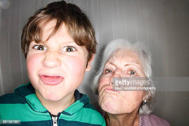 grandson and grandmother making funny face - mamie humour photos et images de collection
