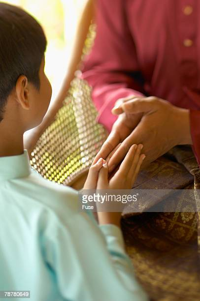 grandson and grandmother - muslim praying stock pictures, royalty-free photos & images
