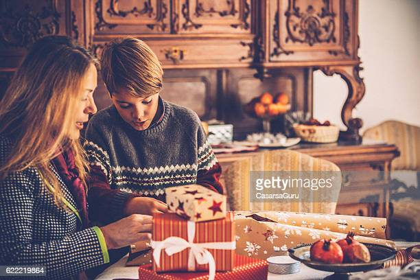 Grandson and Grandmother Wrapping Christmas Presents