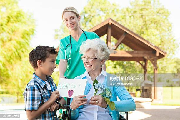 Grandson gives his grandma a birthday present