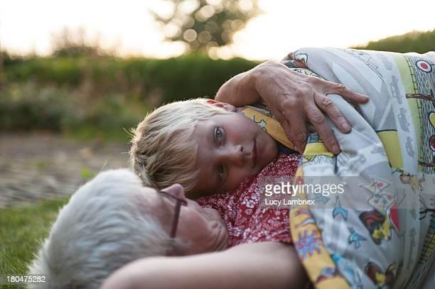 Grandson lying on grandmother