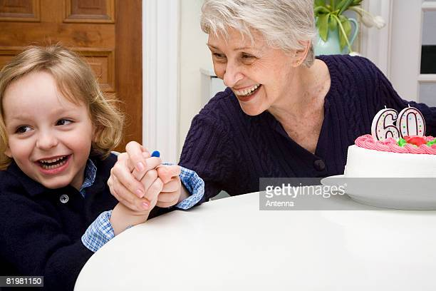 A grandson making mischief and his grandmother catching him