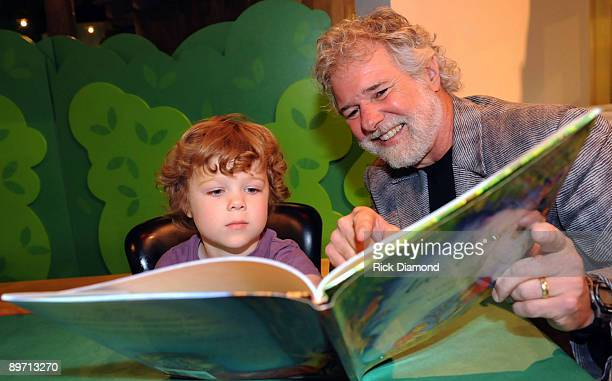 COVERAGE*** Grandson Miles reads with his grandfather Rolling Stones Keyboardist/Tree Farmer Chuck Leavell his children's book 'The Tree...