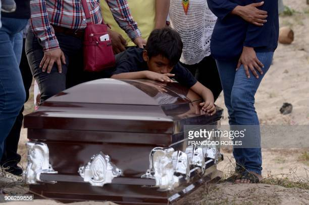 TOPSHOT A grandson of Mexican journalist Carlos Dominguez Rodriguez murdered on January 13 in the state of Tamaulipas mourns over his coffin during...
