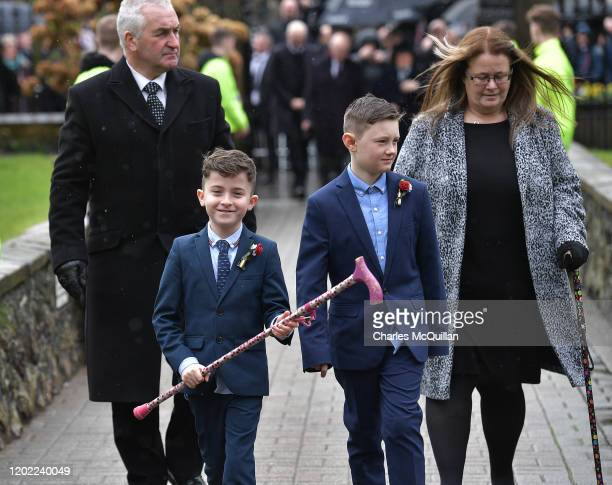 A grandson of the late Harry Gregg carries his walking cane as the funeral of former Manchester United and Northern Ireland footballer takes place on...