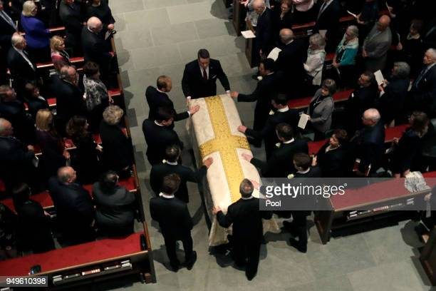 Grandson pallbearers prepare the casket of former first lady Barbara Bush during the funeral service at St Martin's Episcopal Church April 21 2018 in...