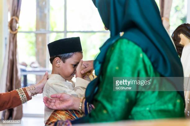Grandson taking blessings during festival of hari raya in Malaysia
