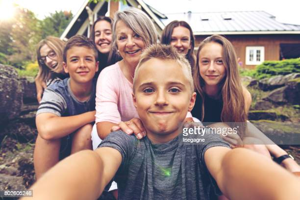 Grandson taking selfie of his grandmother and cousins