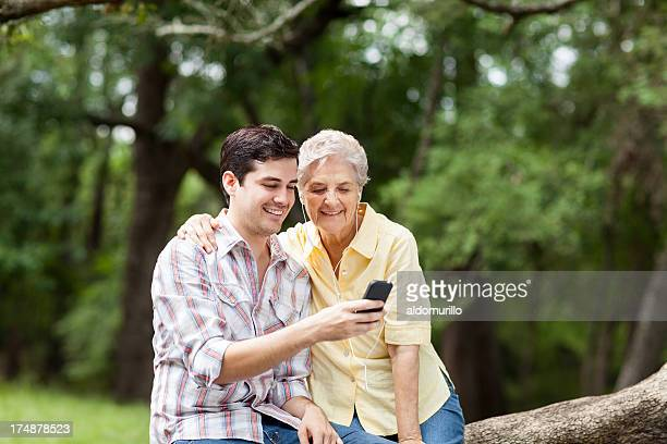 Grandson teaching his grandmother