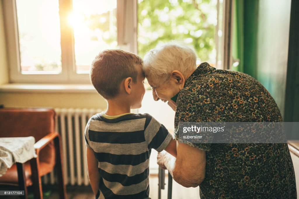 Grandson visiting his granny in nursery : Stock Photo