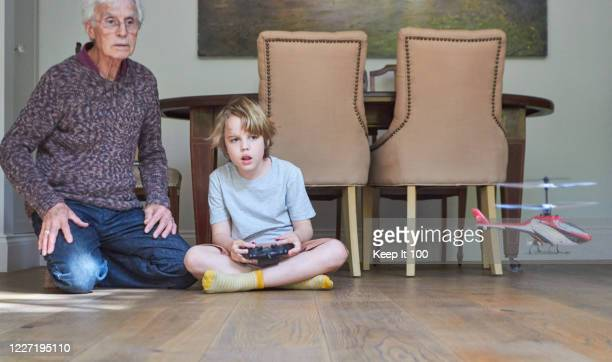 grandson with grandfather - skill stock pictures, royalty-free photos & images