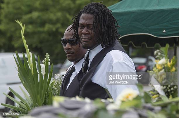 Grandson's of Emanuel AME Church shooting victim Ethel Lance say their goodbye's during her burial at the Emanuel AME Church Cemetery in Charleston...