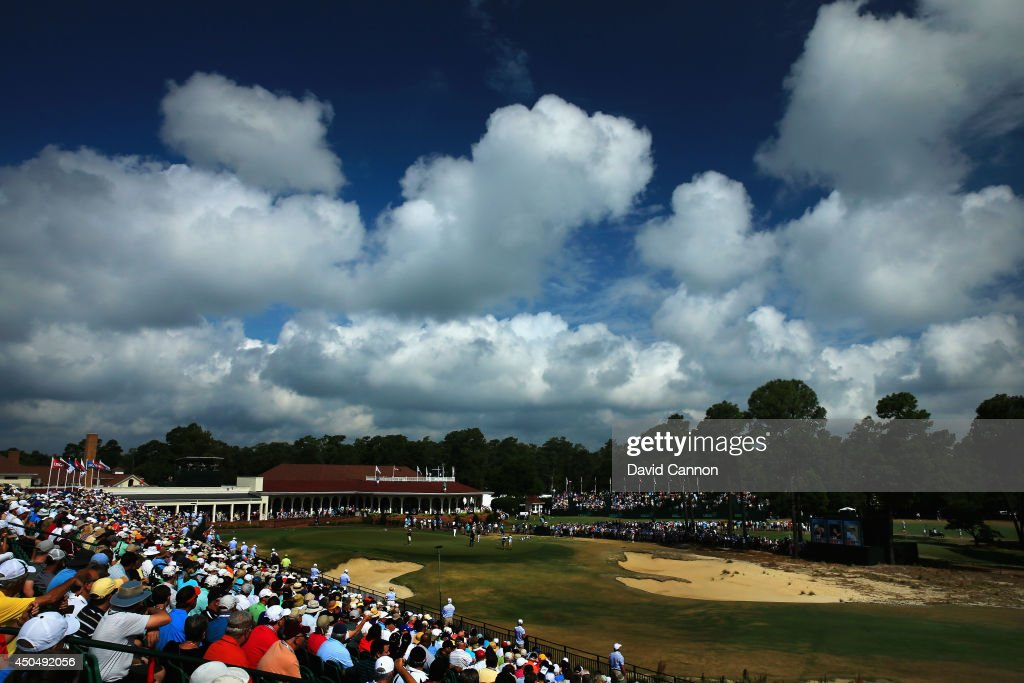 A grandstand of patrons watch the play on the 18th green during the first round of the 114th U.S. Open at Pinehurst Resort & Country Club, Course No. 2 on June 12, 2014 in Pinehurst, North Carolina.