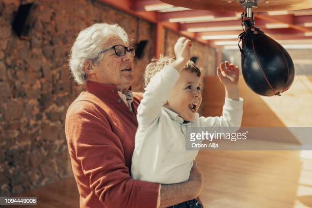 Granfather teaching granson boxing