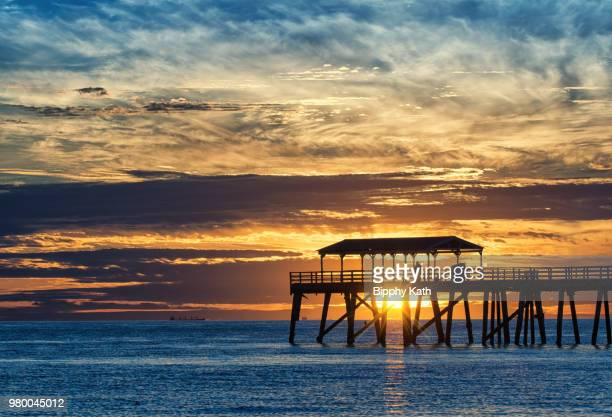 grange jetty at sunset, adelaide, south australia, australia - south australia stock photos and pictures