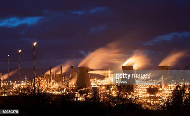 grangemouth petrochemical plant illuminated at night. - flare stack stock photos and pictures