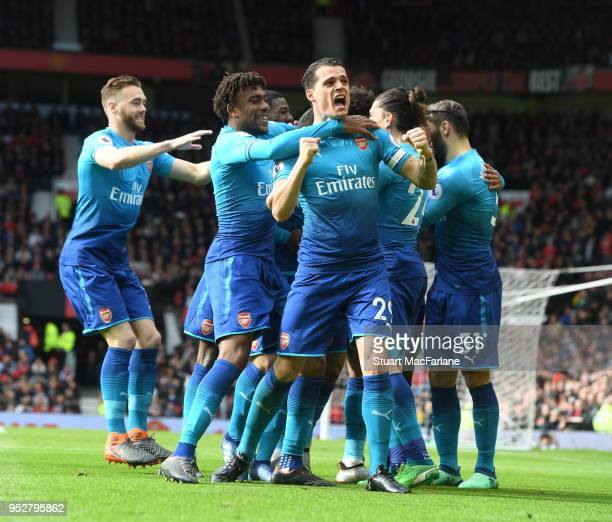Granit Xhaka Alex Iwobi and Calum Chambers celebrate the Arsenal goal scored by Henrikh Mkhitaryan during the Premier League match between Manchester...