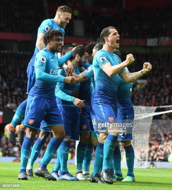Granit Xhaka Alex Iwobi Calum Chambers and Konstantinos Mavropanos celebrate the Arsenal goal scored by Henrikh Mkhitaryan during the Premier League...