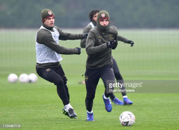 Granit Xhaka and Aaron Ramsey of Arsenal during a training session at London Colney on January 24 2019 in St Albans England
