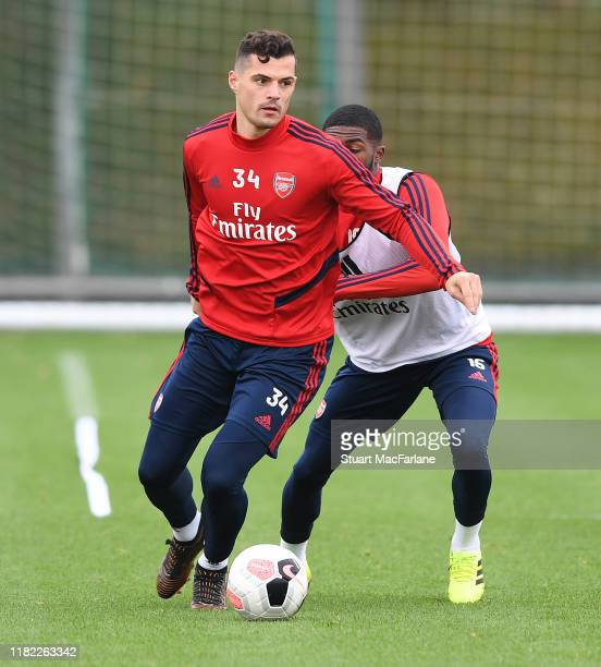 Granit Xhaka and Ainsley Maitland-Niles of Arsenal during a training session at London Colney on October 20, 2019 in St Albans, England.