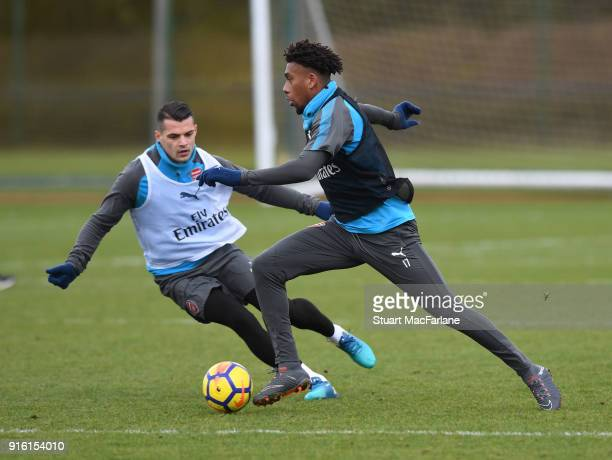 Granit Xhaka and Alex Iwobi of Arsenal during a training session at the London Colney on February 9 2018 in St Albans United Kingdom