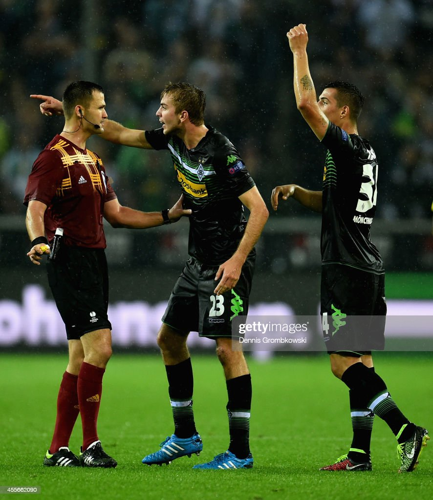 Granit Xhaka and Christoph Kramer of Borussia Moenchengladbach argue with referee Ivan Kruzliak during the UEFA Europa League Group A match between Borussia Moenchengladbach and Villareal CF at Borussia-Park Stadium on September 18, 2014 in Moenchengladbach, Germany.